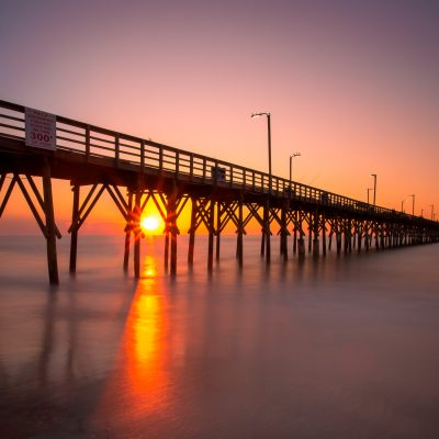 sunrise seaview pier north topsail beach, north carolina - rachel carter images