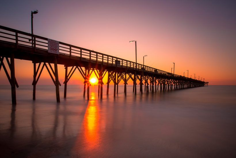 sunrise seaview pier north topsail beach, north carolina - rachel carter images